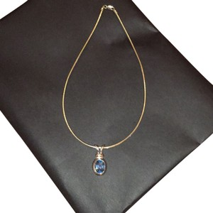 Lord & Taylor 5k Blue Topaz 925 Sterling Silver Necklace. The removable 925 5K topaz is included.. The total weight of the necklace plus the blue topaz charm is approximately 3 ounces.