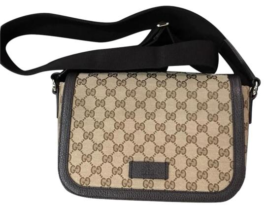 Preload https://img-static.tradesy.com/item/21003573/gucci-canvas-leather-dark-brown-messenger-bag-0-1-540-540.jpg