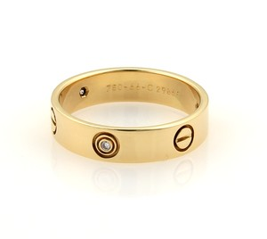 Cartier 11311 - Love 3 Diamonds 18k Yellow Gold 5.5mm Wide Band Ring