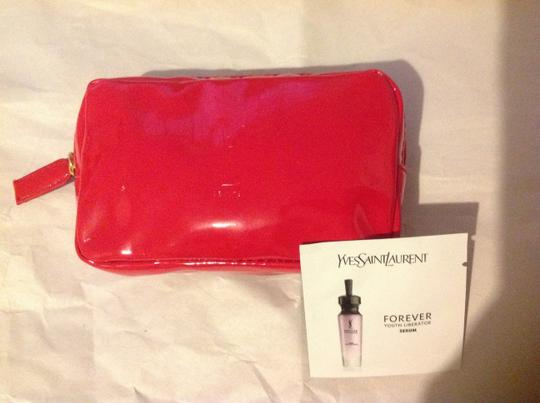 Saint Laurent Ysl forever youth serum sample and red mini cosmetic bag