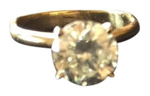 Other 2ct Tiffany set diamond solitaire ring containing an approximate 2ct round, genuine, brilliant cut diamond