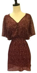 Xhilaration short dress Burgundy With Navy, Yellow And Pale Blue Floral Pattern. on Tradesy