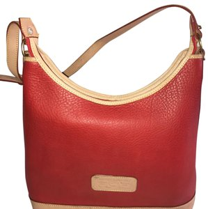 Dooney & Bourke Tote in red with Gold straps .
