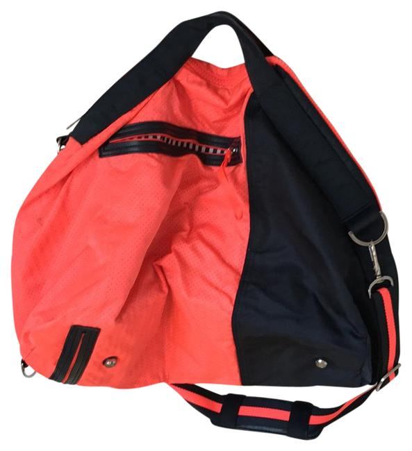 Item - Do It Up Duffel Bright Orange and Blue Nylon Weekend/Travel Bag