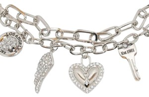 Guess Silver tone chain link multi charm bracelet