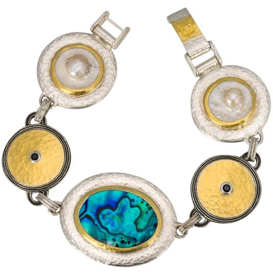 Preload https://img-static.tradesy.com/item/21025990/gurhan-galapagos-sterling-silver-layered-yellow-gold-shell-and-black-spi-bracelet-0-1-540-540.jpg