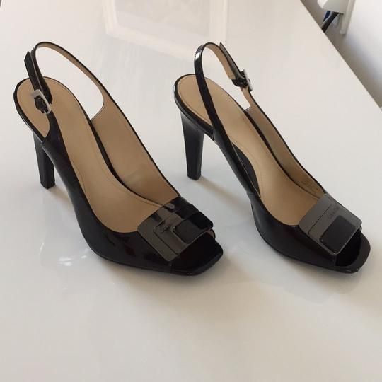 Preload https://img-static.tradesy.com/item/21027429/calvin-klein-black-patent-leather-lisabeth-pumps-size-us-75-regular-m-b-0-0-540-540.jpg