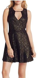 BCBGeneration short dress Black and gold Metallic Lace on Tradesy