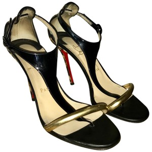 Christian Louboutin Black, gold, and Leopard print Sandals