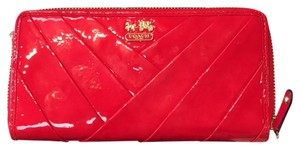 Coach NWT coach red/punch diagonal pattern Patent Leather zip wallet