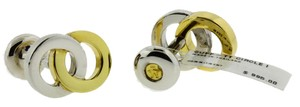 Movado Movado Cufflinks in 18k yellow gold & silver new with tag.