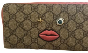 Gucci Embroidered Face zip around wallet