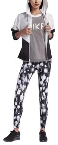Nike Women's Nike Sportwear AOP Legging deliver a flattering, curve hugging look. With an eye catching print, these legging stand out in style. Materials: 82% polyester, 18% spandex Style/Color: 840519-010
