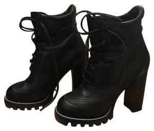 Louis Vuitton Black with white stitching around toe of shoe. Boots
