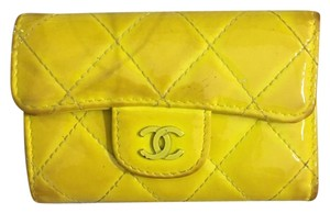 Chanel chanel quilted matelasse yellow patent lambskin key case