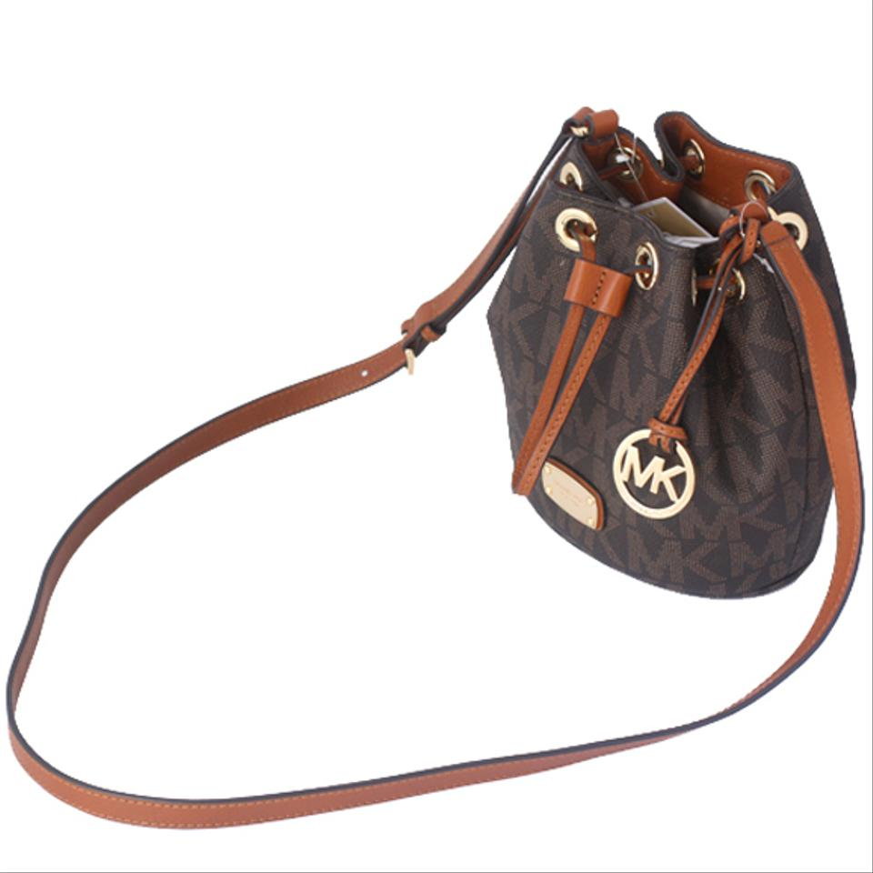 1bb4a283dc87 ... Michael Kors Mini Jules Drawstring Brown Signature Pvc Cross Body Bag -  Tradesy ...