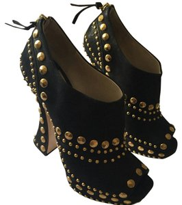 Miu Miu Studded black and gold Boots