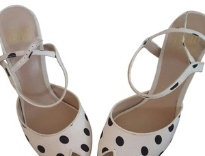 Truth or Dare by Madonna White with black Polk dots. Pumps