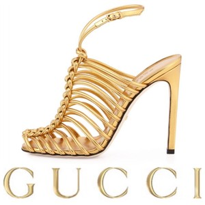 Gucci Gold Pumps