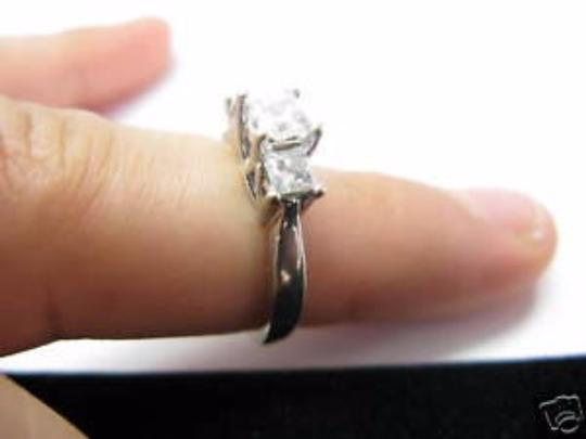 Other Fine 18KT Princess Cut Diamond 3 Stone Engagement Ring