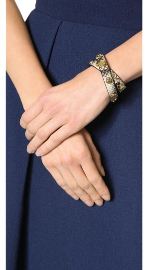 Preload https://item4.tradesy.com/images/tory-burch-silver-gold-double-wrap-leather-with-studs-bracelet-21067498-0-1.jpg?width=440&height=440