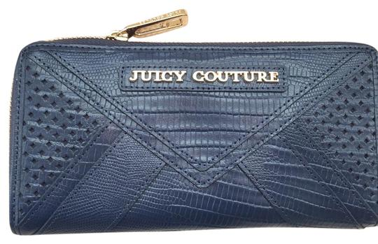 Preload https://item5.tradesy.com/images/juicy-couture-navy-blue-leather-zip-around-wallet-21068754-0-1.jpg?width=440&height=440