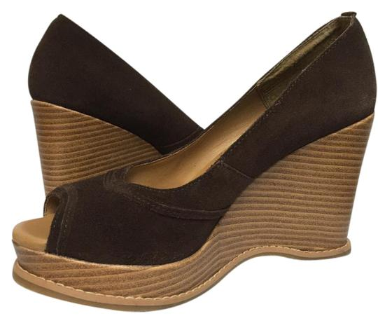 Preload https://item4.tradesy.com/images/massimo-chocolate-brown-wedge-platforms-size-us-75-regular-m-b-21069693-0-1.jpg?width=440&height=440