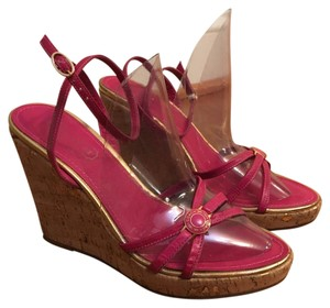 Coach pink/gold Wedges