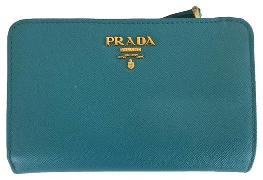 Preload https://item4.tradesy.com/images/prada-turchese-saffiano-in-wallet-2107053-0-0.jpg?width=440&height=440