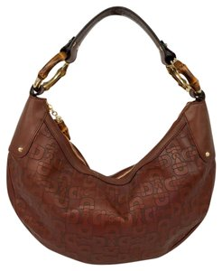 3b7fe3bb0fd Added to Shopping Bag. Gucci Bamboo Horsebit Embossed Hobo Bag. Gucci  Horsebit Embossed Small Brown Leather ...
