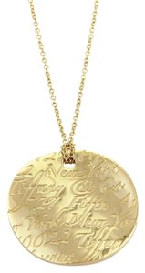 Tiffany & Co. Tiffany Notes 18k Yellow Gold Wrinkle Round Shaped Pendant Necklace