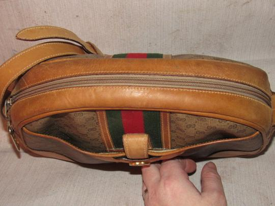 Gucci High-end Bohemian Mint Vintage Exterior Pocket Bowling Look Perfect For Everyday Satchel in brown small G logo print coated canvas & camel leather with red/green striped center Image 1