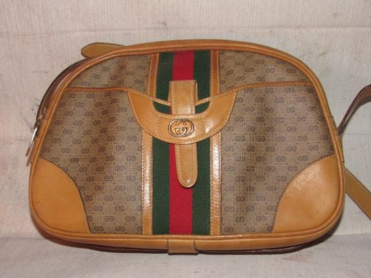Gucci High-end Bohemian Mint Vintage Exterior Pocket Bowling Look Perfect For Everyday Satchel in brown small G logo print coated canvas & camel leather with red/green striped center Image 7