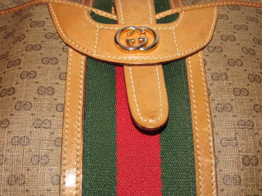 Gucci High-end Bohemian Mint Vintage Exterior Pocket Bowling Look Perfect For Everyday Satchel in brown small G logo print coated canvas & camel leather with red/green striped center Image 8