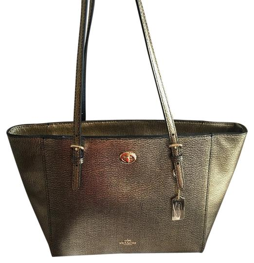 Preload https://img-static.tradesy.com/item/21074216/coach-turnlock-36459-metallic-gold-tote-0-1-540-540.jpg