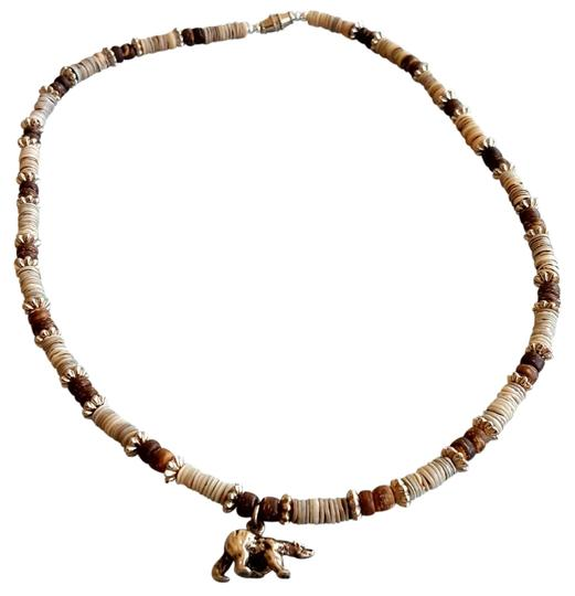 Preload https://img-static.tradesy.com/item/21077397/tan-brown-and-shell-with-bear-charm-necklace-0-3-540-540.jpg