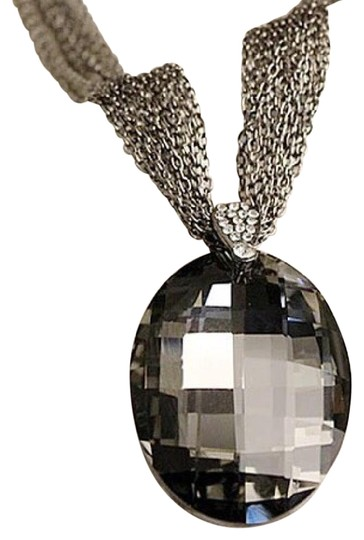Preload https://img-static.tradesy.com/item/21078809/black-and-silver-new-vintage-gold-oval-crystal-pendant-necklace-0-3-540-540.jpg