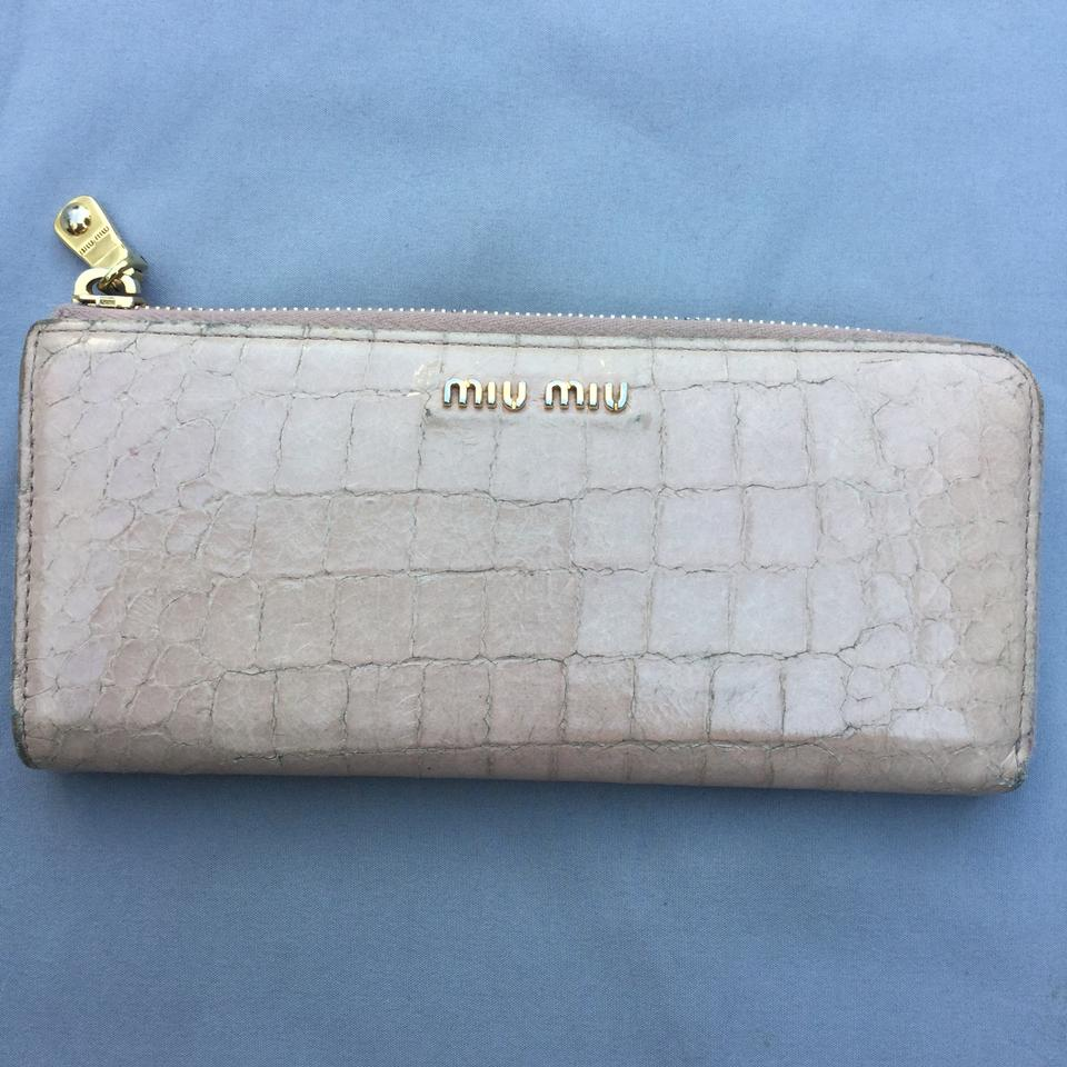 ... retail prices 0335d e3474 Miu Miu crocodile Embossed patent leather  zip-around wallet. 64189a0acc