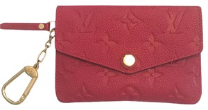 Louis Vuitton cerise empreinte monogram leather cles pouch $50 off today only!