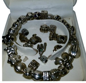PANDORA Bracket with forty+ charms