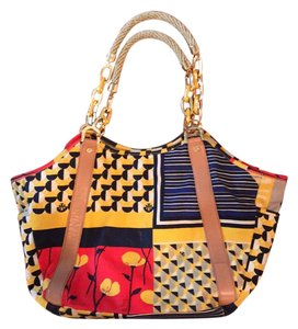Tory Burch Tote Outside is multi - primarily navy, gold, red, black and tan. Inside is tan with multi trim. Beach Bag