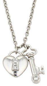 Tiffany co platinum diamond heart lock key charm pendant necklace tiffany co diamond platinum heart lock key charm pendant necklace aloadofball Image collections