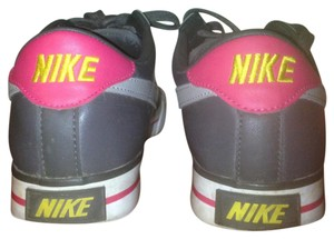 Nike grayish with a little bit of pink Athletic