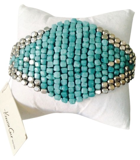 Preload https://item1.tradesy.com/images/kenneth-cole-silverturquoise-silver-tone-mixed-bead-adjustable-friendship-bracelet-2109735-0-0.jpg?width=440&height=440