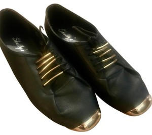 Other black and gold Flats
