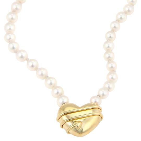 Preload https://img-static.tradesy.com/item/21105364/tiffany-and-co-yellow-gold-18kt-arrow-heart-pendant-salt-water-pearl-necklace-0-1-540-540.jpg