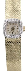 Movado Ladies Movado Watch 14k yellow gold and diamond, gold band