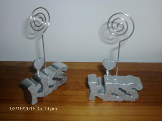 Preload https://img-static.tradesy.com/item/2111128/silver-kiss-table-number-holders-6-count-reception-decoration-0-0-540-540.jpg