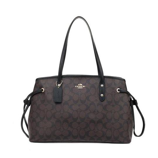 Preload https://img-static.tradesy.com/item/21122059/coach-saddle-signature-drawstring-carryall-khakisaddle-f57842-brownblack-pvc-shoulder-bag-0-0-540-540.jpg