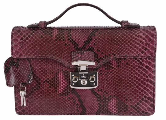 Preload https://img-static.tradesy.com/item/21125587/gucci-new-331823-purple-python-snake-small-lady-lock-structured-wine-snakeskin-satchel-0-0-540-540.jpg